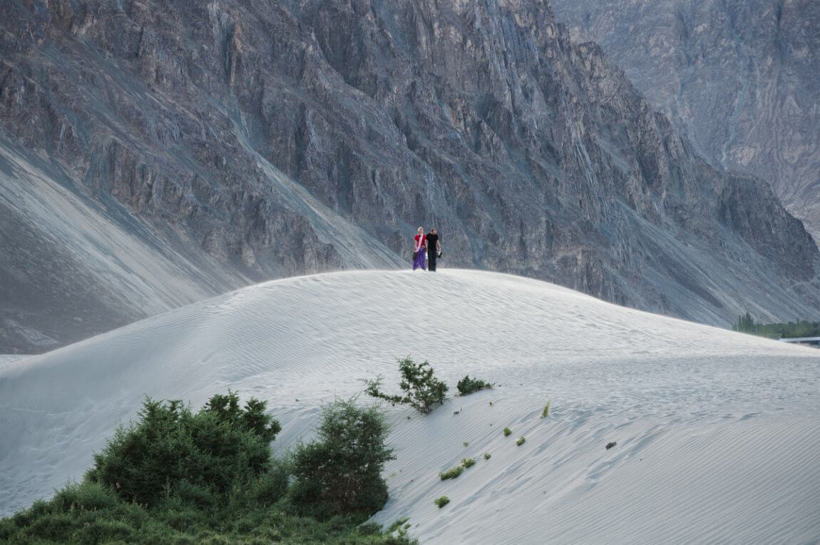 tourists in sand dunes